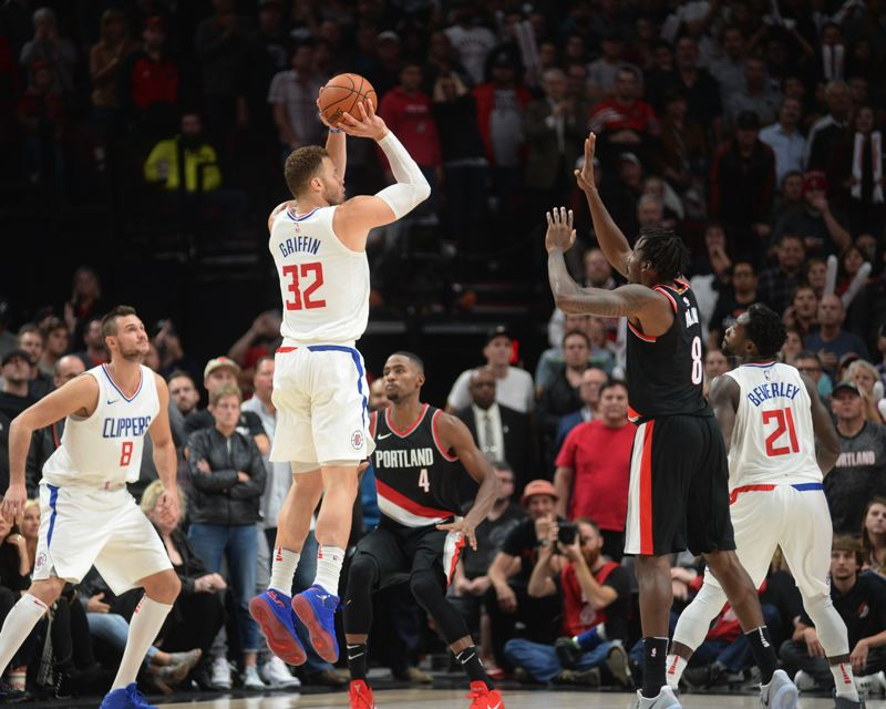 TRIBUNE PHOTO: JOSH KULLA - Blake Griffin goes up for the winning 3-pointer in the final second on Thursday as the Los Angeles Clippers defeat the Trail Blazers 103-103 at Moda Center.
