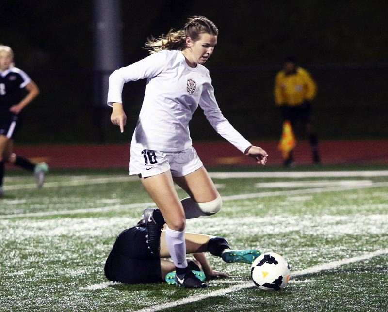 DAN BROOD - Tualatin junior Meghan MacPherson looks to get up field with the ball in the TRL showdown with Sherwood.