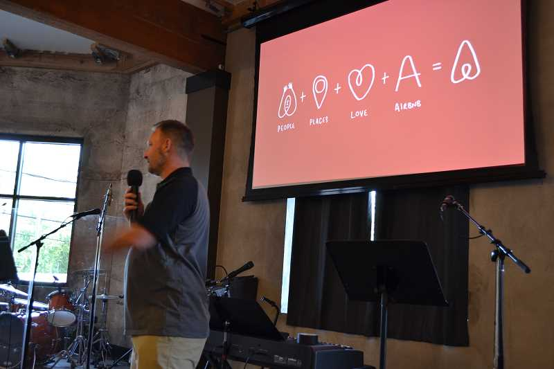 PHOTO COURTESY OF AIRBNB - Multnomah Business Association President Jason Lensch speaks to the crowd at an Airbnb mixer in July.