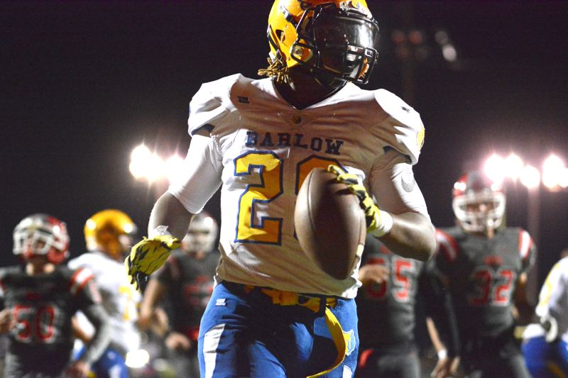 OUTLOOK PHOTO: DAVID BALL - Barlow running back Jobi Malary finds the end zone on an 11-yard run to start the second half in the Bruins 53-22 win at David Douglas last Friday.