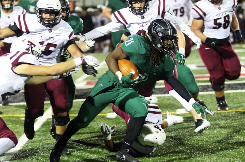 DAN BROOD - Tigard junior running back Malcolm Stockdale looks to gain more yardage during Friday's game.