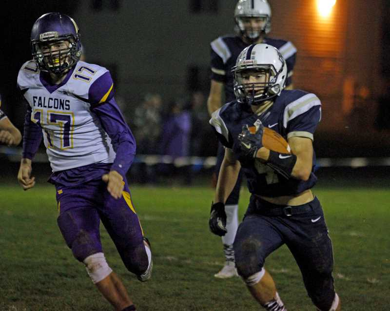 NEWS-TIMES PHOTO: WADE EVANSON - Banks' Gunnar Partain runs around end in the Braves' game against Elmira Oct. 27 at Banks High School.