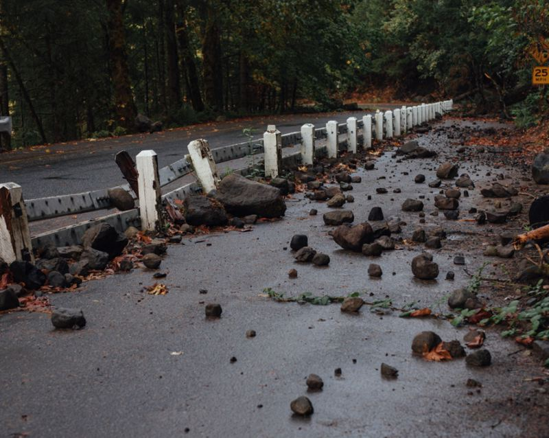 OPB/IAN C. BATES - Rocks, some the size of basketballs, litter the old highway up to Multnomah Falls.