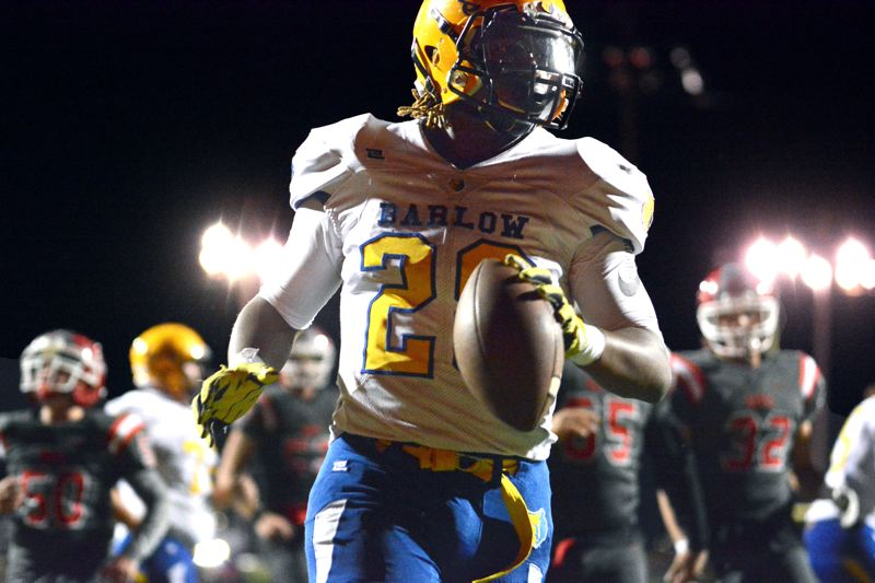 OUTLOOK PHOTO: DAVID BALL - Barlow running back Jobi Malary scores on an 11-yard run and added an 8-yard score a few minutes later to put the Bruins in charge 46-14 midway through the third quarter of their Friday game against David Douglas.