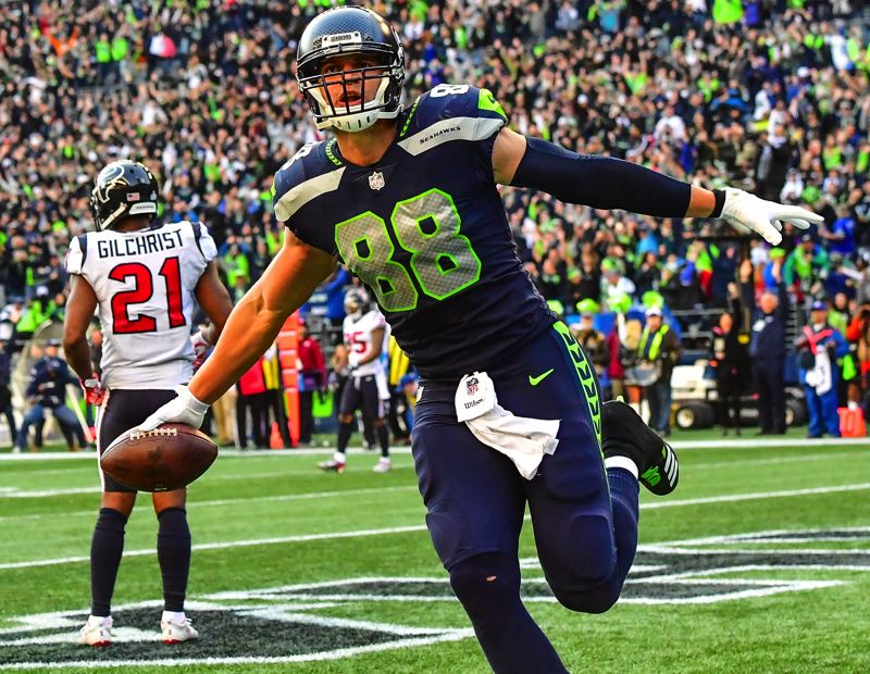 MICHAEL WORKMAN PHOTO - Jimmy Graham has a touchdown catch for the Seahawks.