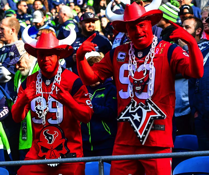 MICHAEL WORKMAN PHOTO - Texans fans try to make Seattle see red.