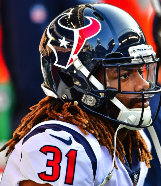 MICHAEL WORKMAN PHOTO - Houston defensive back Treston Decoud, from Oregon State, watches the action Sunday in Seattle.