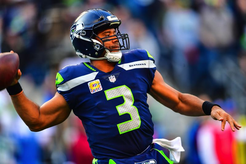 MICHAEL WORKMAN PHOTO - Russell Wilson winds up for a long pass.