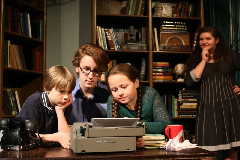 SUBMITTED PHOTO - Conner Williams, center, plays the role of Artekus Krumbe; his efforts on the typewriter are watched over by Ty Schultz-Reynolds, left, and Lizzie Rice, and Gabi Fustolo, back right.