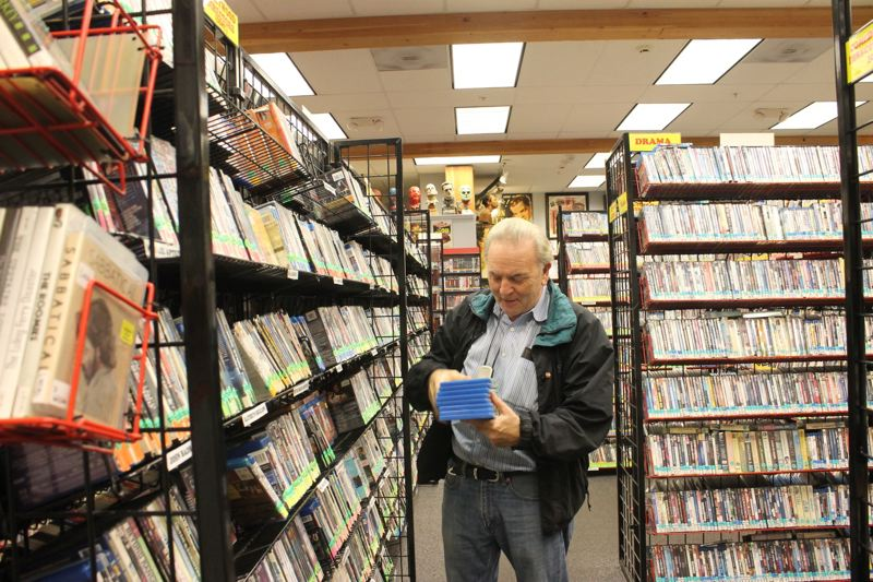 TRIBUNE PHOTO: LYNDSEY HEWITT - Movie Madness owner Mike Clark now gets to settle into retirement — although he'll be around to give tours of the store.