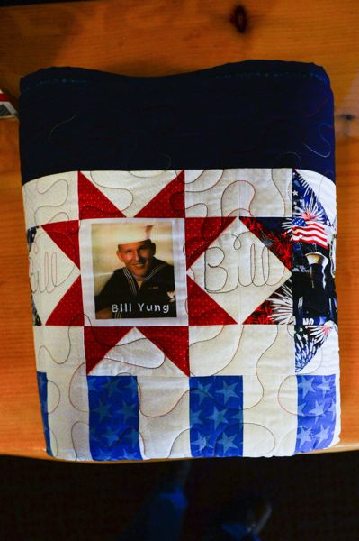 OUTLOOK PHOTO: JOSH KULLA - Gresham military veterans William and Steven Yung were both presented Saturday with handmade quilts honoring their service in the U.S. Navy and Air Force Reserve, respectively.