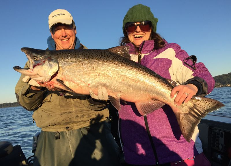 "SUBMITTED - Lauryn Neely of Waco, Texas caught this 23-pound ""honeymoon"" Chinook salmon from Tillamook Bay on October 27. The fish took a herring near the Ghost Hole."
