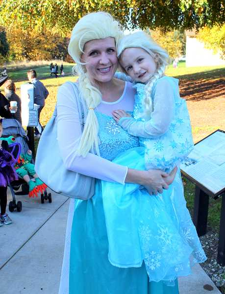 SPOKESMAN PHOTO: CLAIRE GREEN - (Left to right) Maegan and Evie Brooks were twinning as Princess Elsa.
