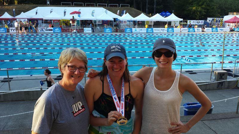 COURTESY - Sara Shepherd, center, poses with mom Becky Shepherd, left, and sister Mary Shepherd after finishing first in the 100-meter backstroke for her age group in U.S. Masters Swimming nationals at Mt. Hood Community College last summer.