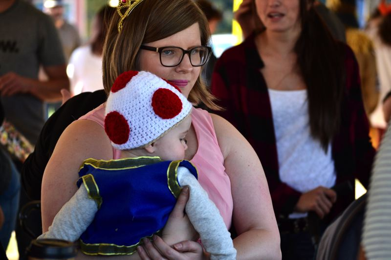 POST PHOTO: BRITTANY ALLEN - People of all ages came out to enjoy the Trick or Treat Trail in downtown Sandy.