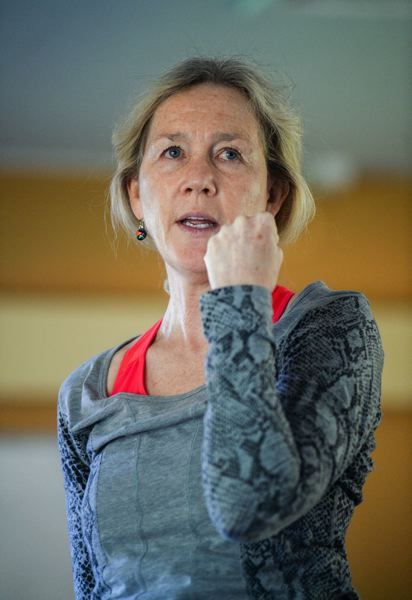 OUTLOOK PHOTO: JOSH KULLA - Yoga instructor Patti Stone urges her students to 'wrap your fingers around what it is you want and pull it in to you with all your might.'
