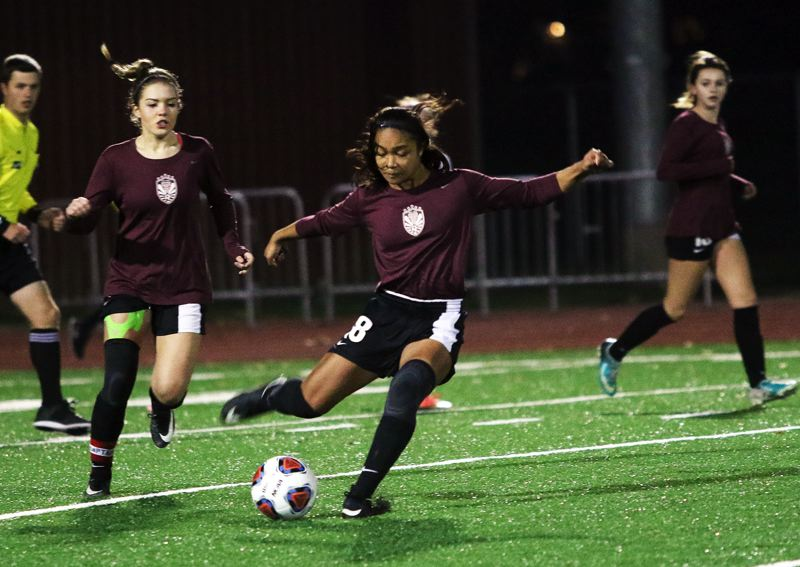 DAN BROOD - Tualatin freshman Cally Togiai scored three goals in the 4-2 state playoff win at Sherwood.