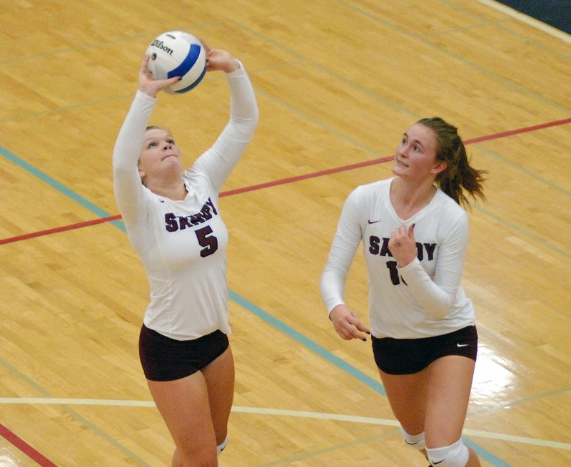 SANDY POST: MATT RAWLINGS - Brooke Dodge (left) sets the ball as Samantha Brewster (right) readies herself for the spike.