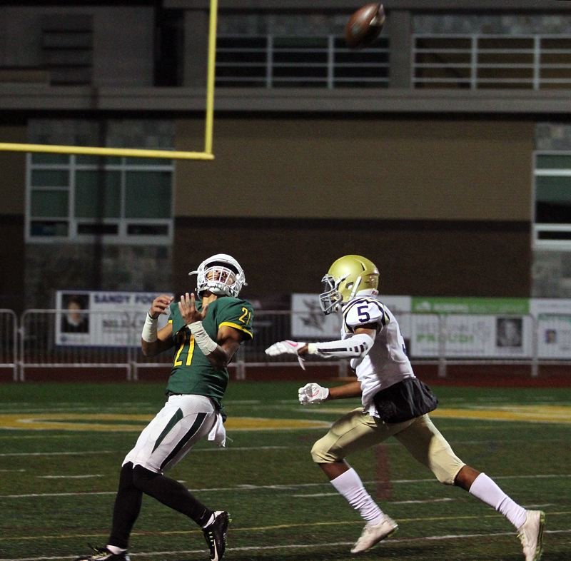 TIDINGS PHOTO: MILES VANCE - West Linn senior Qawi Ntsasa gets ready to try and make a catch during his team's 63-13 win over West Albany in the first round of the Class 6A state playoffs on Friday at West Linn High School.