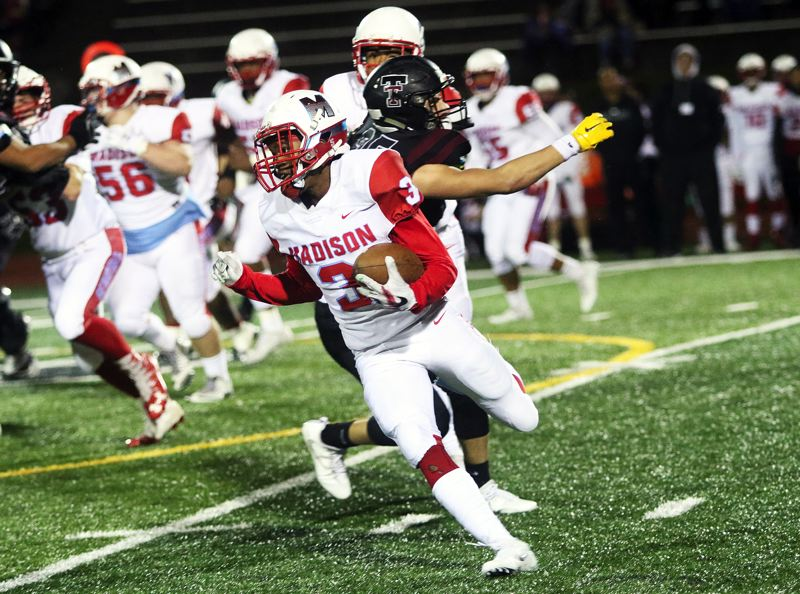 DAN BROOD - Madison senior Michael Noil tries to turn the corner during Friday's state playoff game at Tualatin.