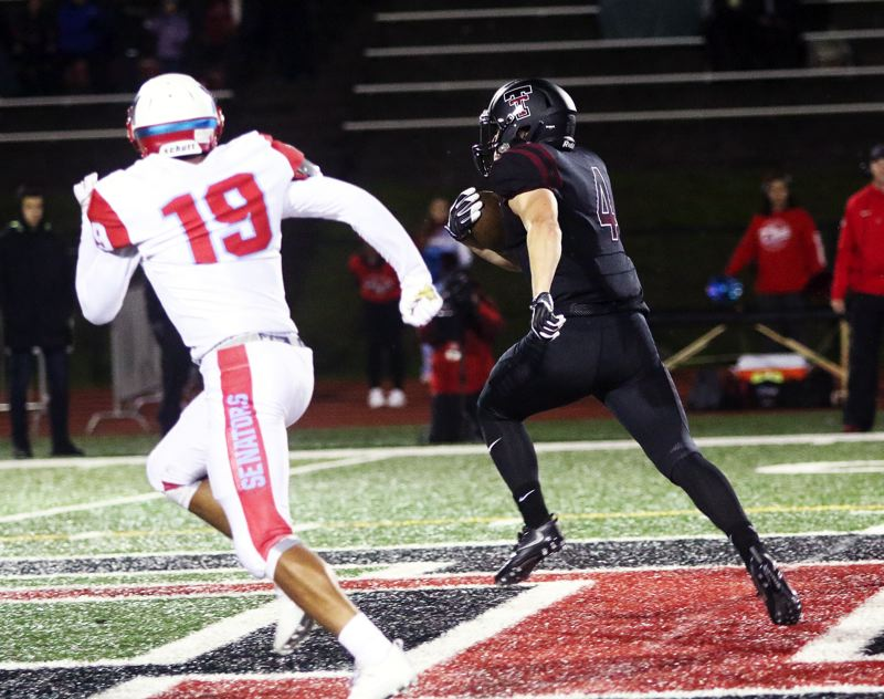 DAN BROOD - Tualatin senior Nathan Marx (4) breaks into the clear on his way to gaining 53 yards on this run in Friday's state playoff game.