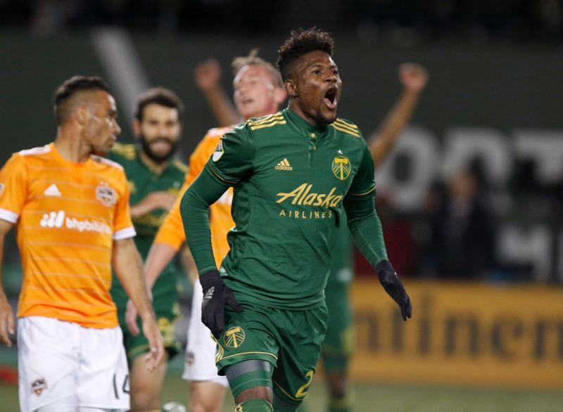 TRIBUNE PHOTO: JONATHAN HOUSE - Dairon Asprilla celebrates his goal Sunday for the Portland Timbers in their MLS playoff game with the Houston Dynamo.