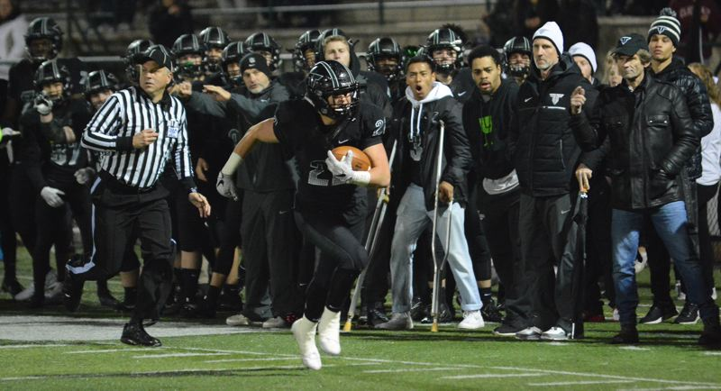 PAMPLIN MEDIA GROUP PHOTO: DAVID BALL - Tigard running back Spencer Smith races around the left side for 27 yards and the winning touchdown in his team's 42-35 home win over Barlow in the first round of the Class 6A state playoffs on Friday.