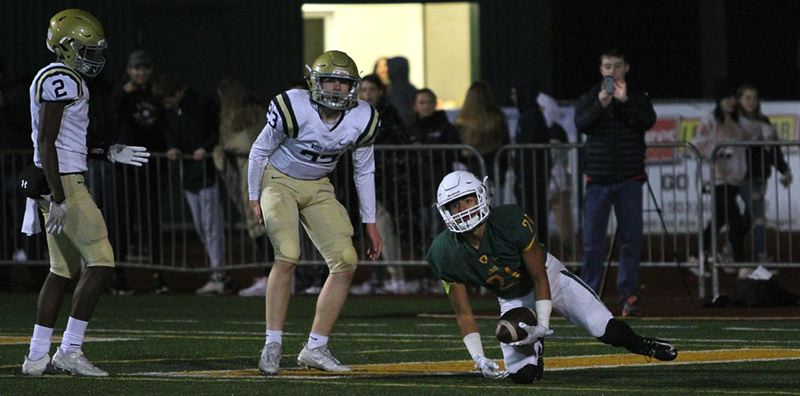 PAMPLIN MEDIA GROUP PHOTO: MILES VANCE - West Linn senior wide receiver Qawi Ntsasa bounces up after making a 45-yard touchdown catch in his team's 63-13 home win over West Albany in the first round of the Class 6A state playoffs on Friday.