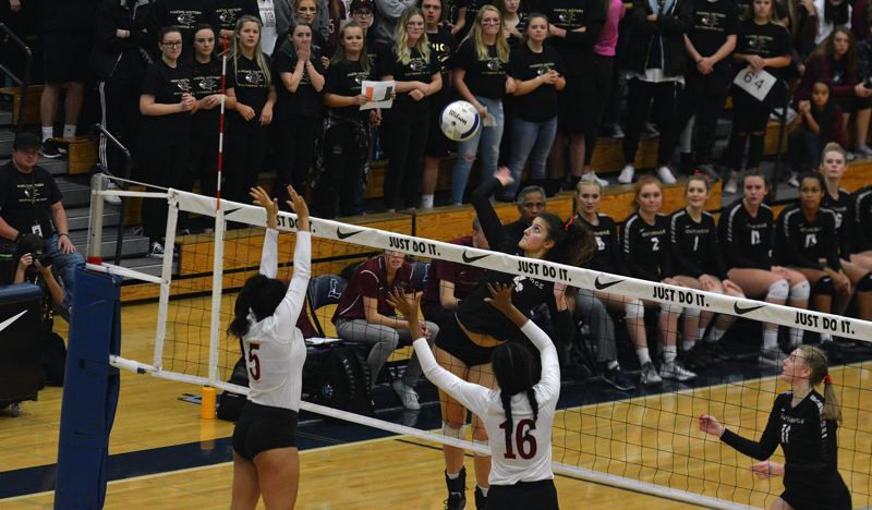 TIMES PHOTO: MATT SINGLEDECKER - Southridge middle blocker Teddy Batinkova goes up high for a kill attempt against Central Catholic in the Class 6A state title game.