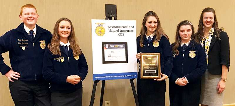 SUBMITTED PHOTO - From left to right, members of the Newberg FFA Environmental and Natural Resources team Todd Halleman, Kennedy Rainey, Abigayle Darula and Kylie Holveck, along with NHS FFA advisor Bailey Field, show off their bronze award from the FFA National Convention last month.