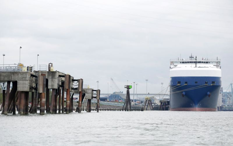 TRIBUNE PHOTO: JONATHAN HOUSE  - A ship waits at the Port of Vancouver, where a massive oil-by-rail terminal is proposed by Tesoro Corp. and Savage. Tuesday's election may wind up killing the project.