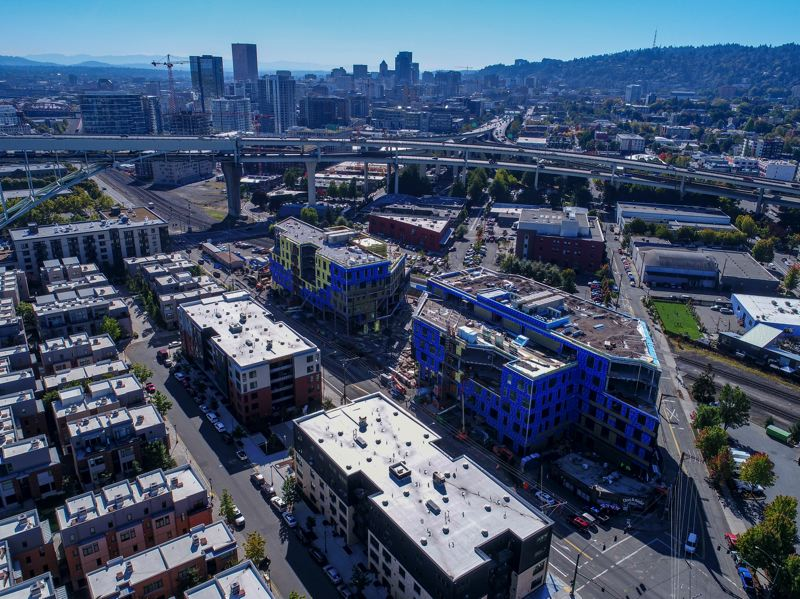 COURTESY: HACKER - Field Offce, the two blue buildings at center, has two tenants lined up for its opening in 2018.