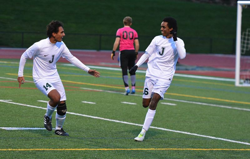 TIMES PHOTO: MATT SINGLEDECKER - Jesuit seniors Seifu Zerabruk and Samir Johnson celebrate a first half goal against South Eugene. The Crusaders take on Westview in the Class 6A state championship game on Saturday.