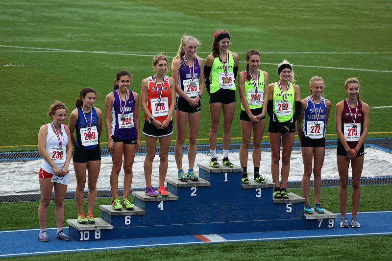 TIMES PHOTO: ADAM WICKHAM - Jesuit junior Makenna Schumacher won her first ever state championship and was surrounded by a number of Metro League entrants including Sunset senior Kelly Makin who took second.
