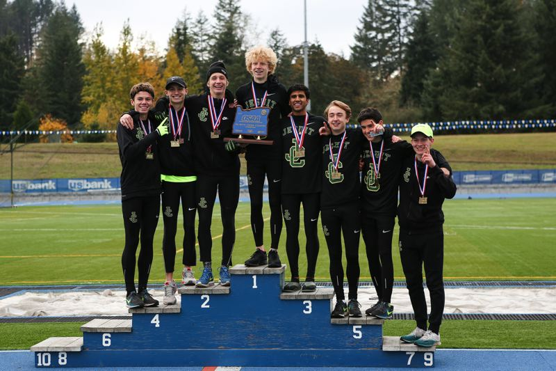TIMES PHOTO: ADAM WICKHAM - The Jesuit boys cross country team won its first Class 6A state championship since 2008 on Saturday.