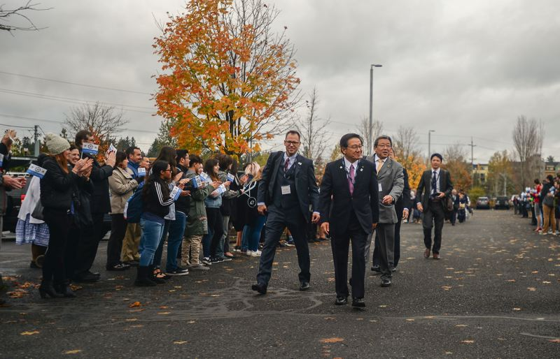 OUTLOOK PHOTO: JOSH KULLA - Sister City delegates from Ebetsu, Japan, are greeted Monday at Gresham City Hall by hundreds of city employees lining the parking lot.