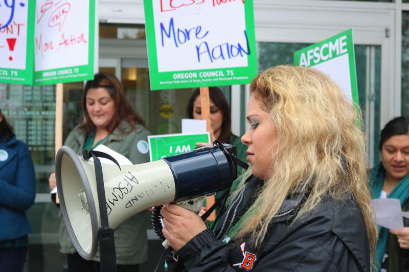 OUTLOOK PHOTO: ZANE SPARLING - Medical assistant Josefa Gonzalez leads chants in Spanish and English on Friday, Nov. 3, during a walk out protesting the unsigned contract for members of Local 88.