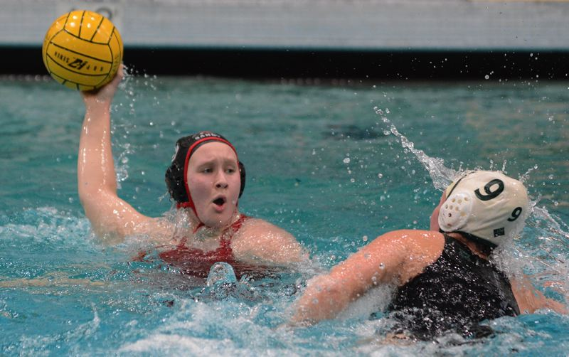 SANDY POST: DAVID BALL - Sandys Hannah Gillies prepares to fire a shot against Summits Conner Hamlin during the Pioneers 12-6 semifinal win Friday.