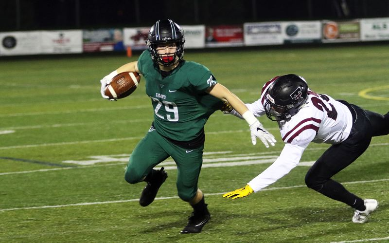 DAN BROOD - Tigard senior Spencer Smith looks to get away from Tualatin's Ivan Garibay during Friday's game.