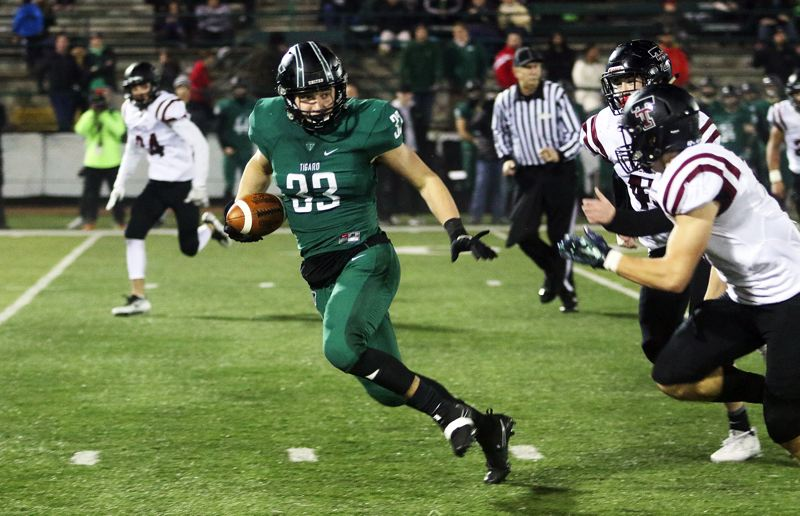 DAN BROOD - Tigard senior tight end Kyle Bay heads up field after catching a pass in Friday's game.