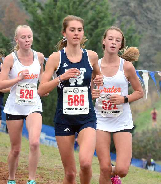 SPOKESMAN PHOTO: TANNER RUSS - Junior Kaitlyn Dougall was Wilsonvilles third finisher at the state meet, and helped contribute to the teams success in getting first place at districts.