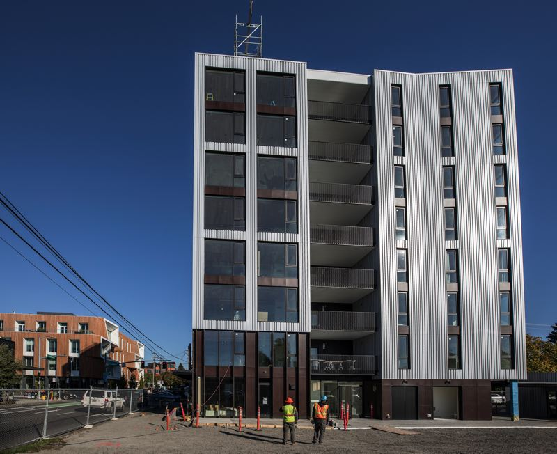 PAMPLIN MEDIA GROUP - A new building made of cross-laminated timber goes up in Portland.