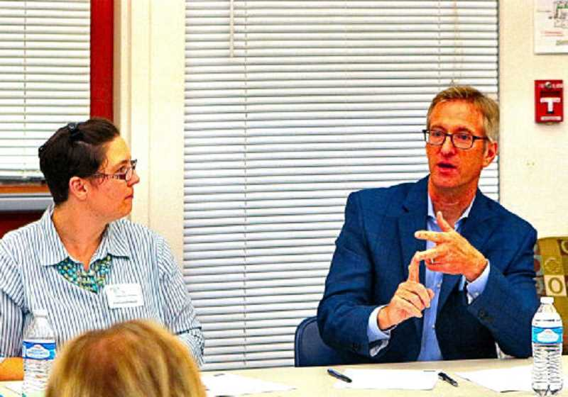 DAVID F. ASHTON - At its November meeting, Brentwood Darlington Neighborhood Assn. Chair Chelsea Powers listened while Portland Mayor Ted Wheeler spoke about livability issues in the neighborhood.