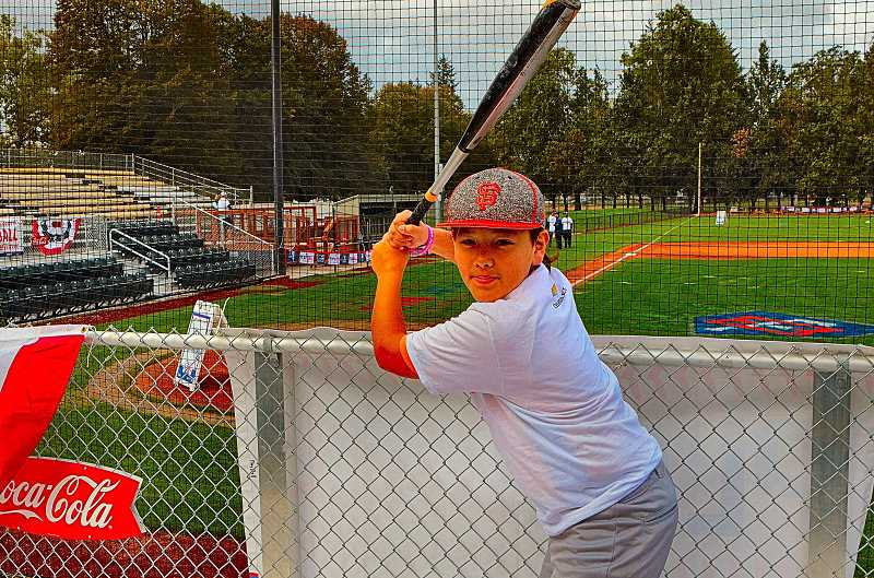 DAVID F. ASHTON - Sellwood Middle School sixth-grader Bryce Fujimoto showed his professional-looking batting stance, as the Play Ball Portland Clinic got underway.