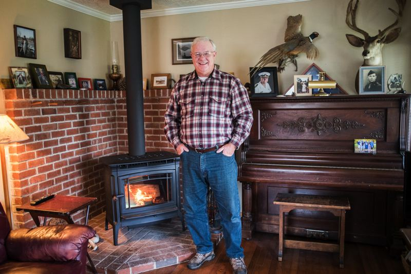 CHASE ALLGOOD; PAMPLIN MEDIA GROUP  - Raymond Dreyer of Beaverton replaced an old woodstove with a cleaner-burning new one, using subsidies granted by Washington County. Multnomah County is considering banning use of such stoves during days when the air quality is bad.