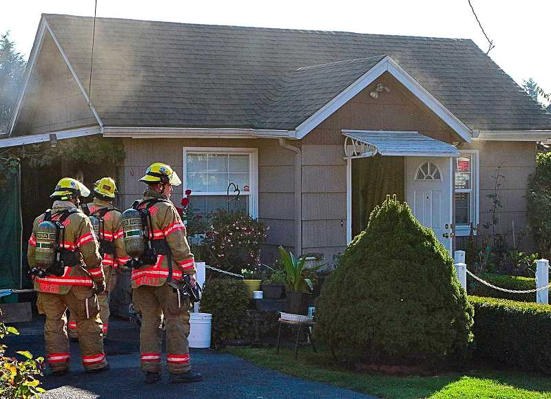 DAVID F. ASHTON - Many fire units responded to this Rural Street house fire, believed to have started in the carport.