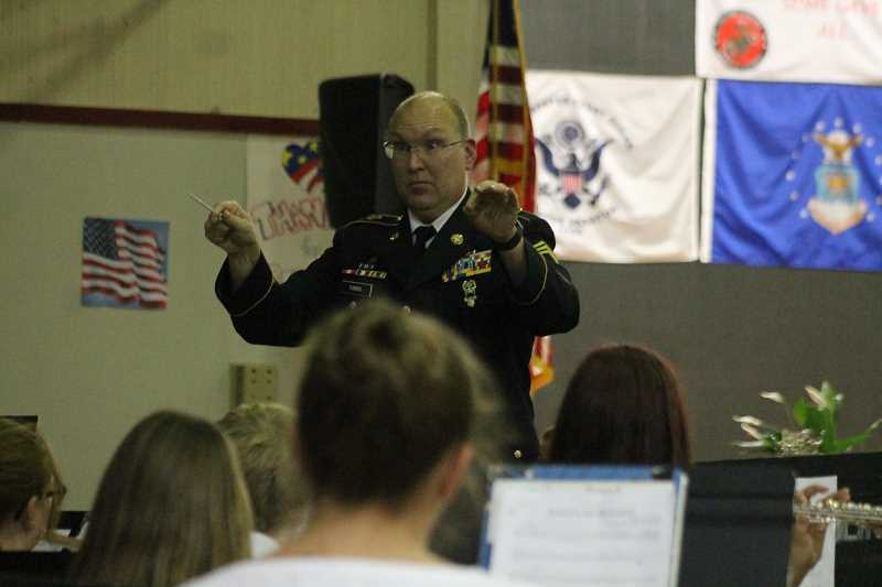 PIONEER PHOTO: CONNER WILLIAMS - Molalla River Middle School band director Matt Farris leads the band in playing the National Anthem during the annual Veterans Day Program at MRMS Nov. 8.