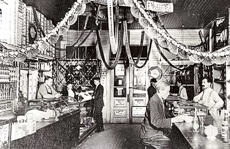 COURTESY OF SMILE HISTORY COMMITTEE - This is a picture of a confectionery called Kiddies Corner; in the early 1900s it was on the northeast corner of S.E. 17th and Tacoma. Kiddies Corner must have been a busy place; there are four clerks waiting on customers here. By 1910 it was operated by the Barto family - Emery, Clarence, and finally Charles. It was known to locals as Bartos Grocery for over 50 years. Later there was a service station there; then it became Pine Street Mini Mart, and it is now a 7-Eleven convenience store.