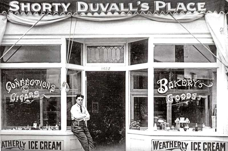 COURTESY OF SMILE HISTORY COMMITTEE - In 1914 there were over 150 confectioneries listed in the Portland area; many of them looked like this one run by Shorty Duvall. Lester C. Shorty Duvall lived in Sellwood during his early years, l and at one time was a baker for the Sunrise Bakery at the corner of 17th and Harney. No trace of Shorty Duvalls Place can now be located in Sellwood, but maybe one of our readers will know where this store was.