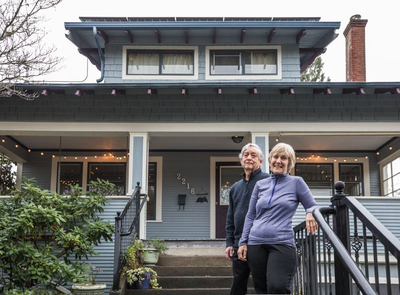 TRIBUNE PHOTO: JONATHAN HOUSE - Lynn Merrick and her husband, Michael Kronenthal, in front of their Mt. Tabor home, which turned out to be less energy-efficient than they expected once they saw their Home Energy Score.